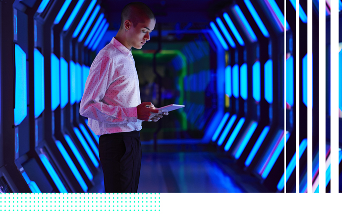 Guy with blue servers in background
